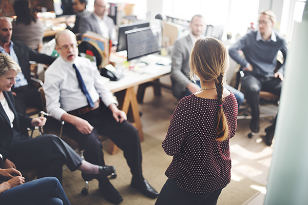woman presenting to office