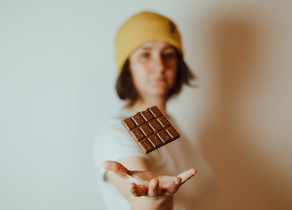 photo of woman and chocolate product