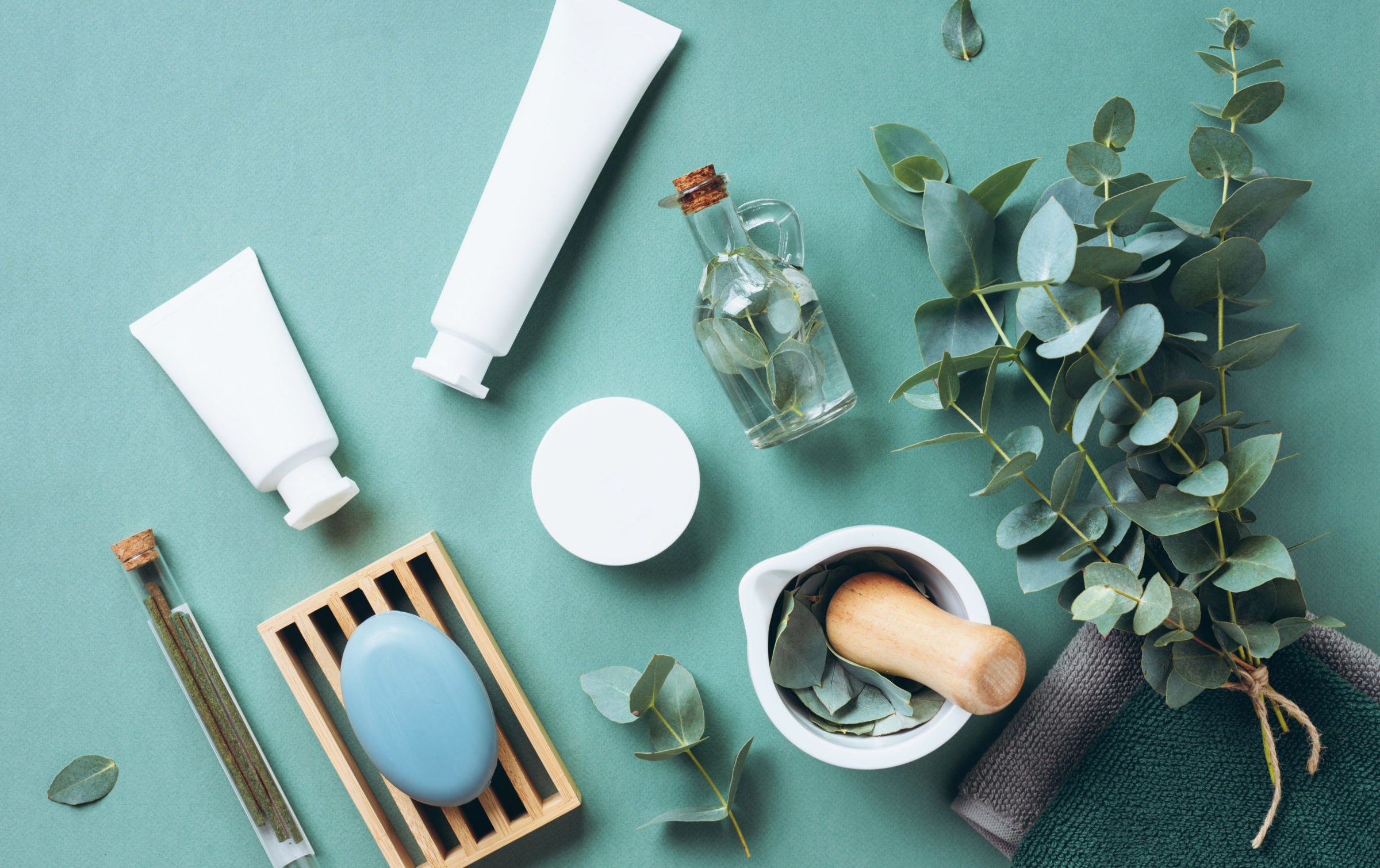 scattered pile of body care products with leaves around to reflect clean label products